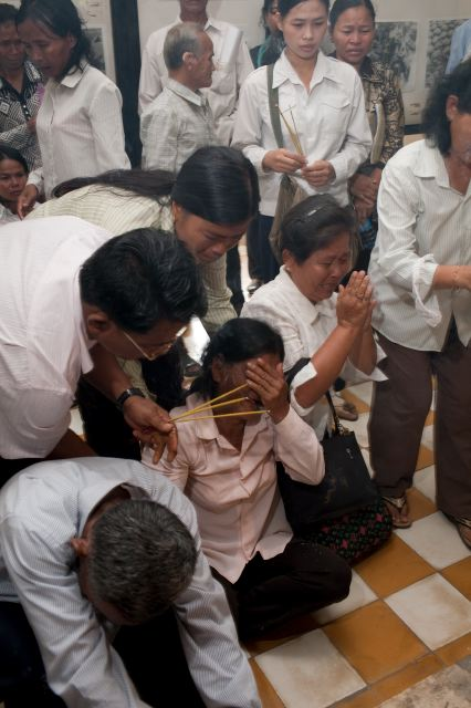 CAMBODIA. Phnom Penh. 31/08/2009: Emotional scenes during the prayer of civil parties at Tuol Sleng Museum.