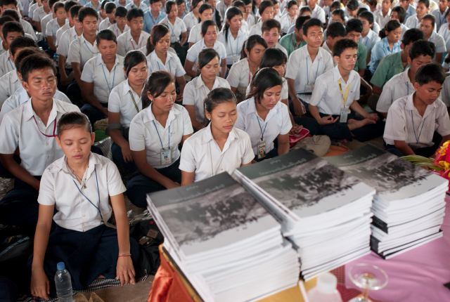 CAMBODIA. Phnom Penh (Phnom Penh). 29/05/2009: Students of PSE (Pour un Sourire d'Enfant) during their weekly meditation time before DCCAM (Documentation Center of Cambodia) distributes copies of its latest publication, a schoolbook about the Khmer Rouge regime.